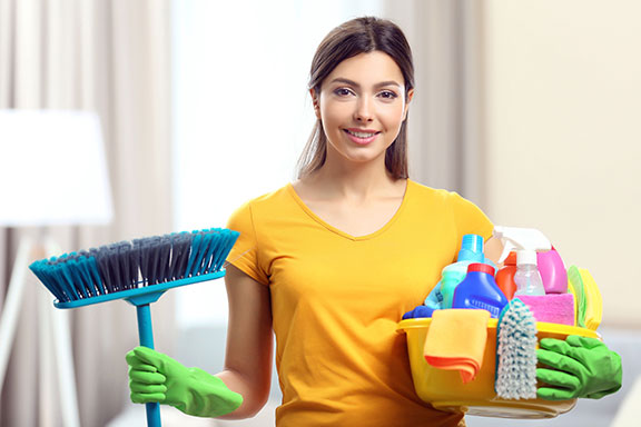 woman who has window cleaning equipment