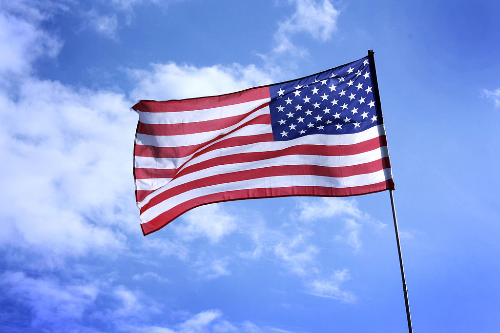 American flag flying over a blue sky