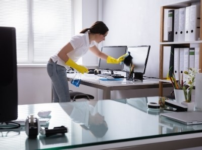 Lady cleaning an office space in Palm Desert